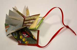 """Ornament"" Folded structure. Materials: bookboard, old Children's Christmas Book, Ribbon"